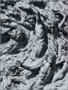 "Frederick E. Hart (American sculptor, 1943-1999) Detail from ""Ex Nihilo"" in Indiana limestone above tympanum doors on West facade of Washington National Cathedral (Washington D.C., USA) Eight swirling figures representing Adam and Eve being created ""Ex Nihilo"" (Out of Nothing). Based on the theology of Jesuit theologian and philosopher Pierre Teilhard de Chardin, who stated that mankind was in a constant state of ""becoming""."