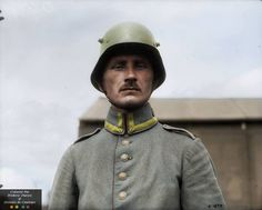 The German soldier is photographed in the steel helmet M1916, in July 1917 captured Canadians.