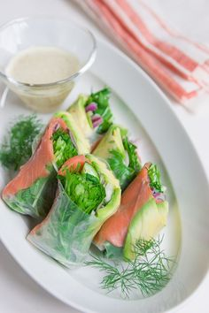 Smoked salmon, avocado and dill summer roll with a caraway honey