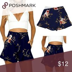 NWOT High waisted floral shorts NWOT High waisted floral shorts with pockets and belt. Size small Super cute. Shorts