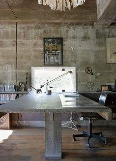 Coool desk! Also, love the gears on the wall.  Austerity: concrete desk