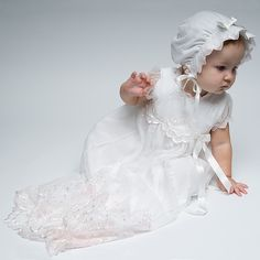 The Joli Christening Gown is an elegant full length heirloom Christening Gown.  Designed with 100% cotton and an embroidered netting with a pale pink and antique white floral pattern. A beautiful heirloom christening gown for your little one.