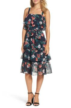 Be party-ready in this tiered, floral print, ruffly dress featuring lively  flowers.