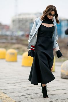 A midi dress paired with a bomber jacket and heeled booties.