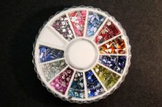 Professional 3D DIAMANTE Nail Art Glitter Rhinestones in MIXED SHAPES with Wheel And Extra by La Demoiselle. $5.99. Bonus: Random color mini beads sample. Approx. 40-60pcs. Size : 2 - 3mm approx. Create your own pattern and add shiny colors to your nail art!. Different shapes and colours. Red, Green, Blue, Yellow, Black, Purple, Pink, etc. and stars, hearts, flowers, moon, etc... Approx. 1500 glitters in the wheel, 12 different shapes. These beautiful diamante rhinestones gleam...