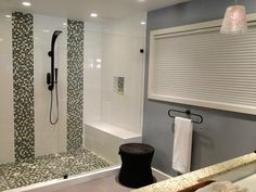 The 10 Best DIY Bathroom Projects: If you have a large bathtub that doesn't get used much, replace it with a walk-in shower. Not only will it look more luxurious, it's more practical. And with a set of clear glass doors, a walk-in shower will make the room feel bigger. From DIYnetwork.com