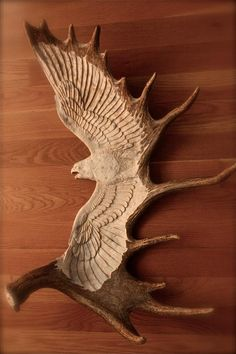 Falcon carved out of moose antler