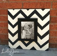 DIY Chevron frame - Paint wooden board and glue on picture frame. - Sand it after to give it an antiqued look.