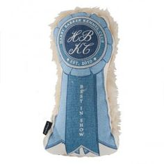 Best In Show Ribbon Dog Squeak Toy   Machine washable and made from cotton canvas, azo-free dyes, and faux fur backing. It has a two way squeaker for double the fun and is stuffed with hypo-allergenic, eco-fiberfill made from 100% recycled bottles. A great green gift!  #blueribbon #ribbon #dog #toy #winner www.shopbluehorse.com