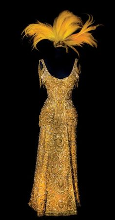 """Worn by Barbra Streisand in Hello Dolly.  Costing well above $100,000 to create in 1969, this dress remains etched in history as one of the """"most expensive dress ever made for a film"""". Weighing over 0.5 pounds, the dress is crafted using 14K gold thread, jewels and coloured gemstones like Swarovski crystals that shine and shimmer under lights.  #Hollywood #musicals #costumes"""