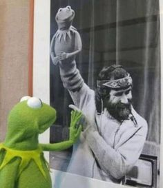 Kermit is contemplating the meaning of his existence. Here he sees his creator Jim Hensen holding him as a puppet. He realizes that he lives in a world of cause and effect and others choices can dictate his life.