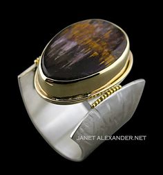 Argentium Silver ring with 24k gold, stone, Cacoxenite in Amethyst is set in 14k gold. Adjustable ring.