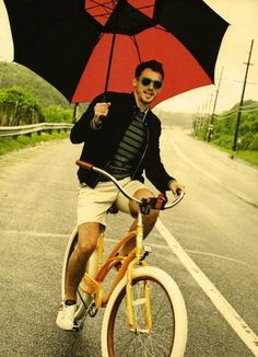 riding a bike with an umbrella is obviously a really stupid idea, but the outfit is great