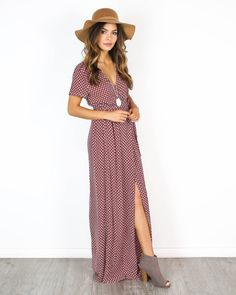 We have never seen anything more beautiful than our Joeli Wrap Maxi Dress! A romantic and rich rust hued maxi with a subtle white floral detail. Wraps interiorly and again on the font with a tie that