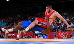 http://www.MilitaryGradeNutritionals.com/blog  Cuba's Mijaín López Núñez, in blue, tackles Abdelrahman Eltrabily of Egypt in the men's 120kg Greco-Roman wrestling.