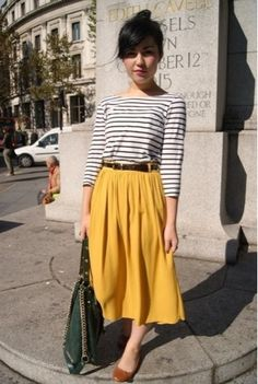 Classic striped shirt, ballet flats, and a sunny yellow midi skirt.