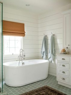 lovely bathroom. Loved the wood planked wall & free standing tub!