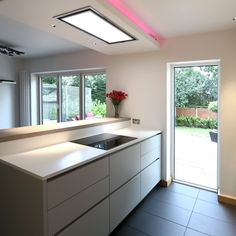 Having a large fixed window is the perfect choice to brighten up this kitchen. The light coming in can bounce off the bright surfaces increasing the perceived size of the interior living space. Visually, the large window acts as an extension of the three pane bifold door, offering broad views of the garden. For technical product details head over to our website. Aluminium Windows And Doors, Casement Windows, Modern Windows, Large Windows, Ral Colours, Home Renovation, Living Spaces, Contemporary, Website