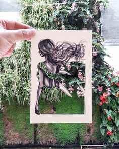 "Jordan-based illustrator Shamekh Al-Bluwi continues to combine his love of architecture with fashion through his clever cut-out series. ""I always used to sketch ladies and dress them with interesting patterns and cityscapes,"" he told The Creators Project. Shamekh's clever and inspiring project involves a series of drawings of women with their dress designs cut out. The illustrator holds the cut-outs up against the world around him. The empty portion is then filled with the buildings…"