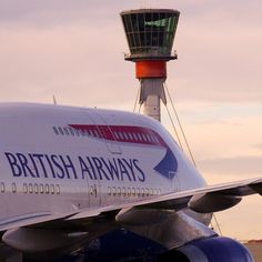 A British Airways Boeing 747: In Front of The  Air Traffic Control Tower at London-Heathrow Airport. (Where would aviation be without the dedicated staff of ATC throughout the world?!  You ALL do a fantastic job! Thank you, it's appreciated.)