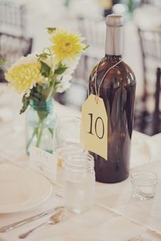 Wine bottle centerpieces : did this at MY winery wedding reception Wine Bottle Centerpieces, Wedding Wine Bottles, Wedding Centerpieces, Wedding Decorations, Black Centerpieces, Bottle Decorations, Centerpiece Ideas, Our Wedding, Wedding Reception