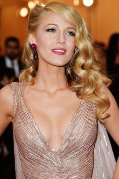 Why Blake Lively's Hair Always Looks So Damn Good  #refinery29  http://www.refinery29.com/2016/04/107917/blake-lively-hairstyles#slide-16  In a nod to '40s glamour, Blake's hair for the 2014 Met Gala combined a deep side part, victory rolls, and loose finger waves for a look that's enviable in any decade....