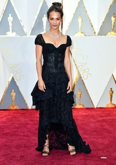 Alicia Vikander (last year's winner for best supporting actress) wore black lace.