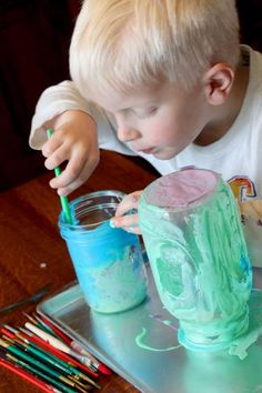Paint the Mason jars with colored glue (inside or out!)
