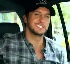Luke Bryan and his crooked grin..:)