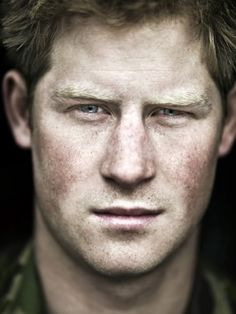 Prince Harry looks decideingly manly and ruggedly handsome.  Without the attitude!