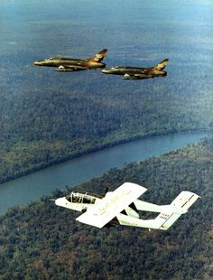 OV-10 Bronco with F-100 Super Sabres over Vietnam in 1969.