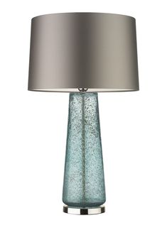 CAIUS MINERAL The Caius lamp is a beautifully textured, mould blown glass piece. The gentle golden hue and stippled surface effect give the lamp an air of luxury and grandeur. This design is individually crafted and will vary from piece to piece.