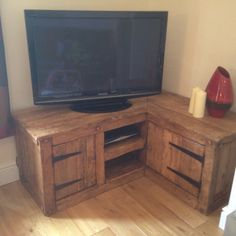 Tv corner unit made from reclainef hardwood. by Wildwoodfurniture