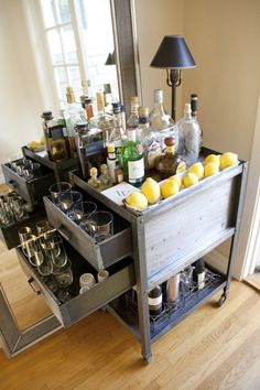 Love this old utility cart with drawers reworked as a bar cart.  Great storage for highball and wine glasses.
