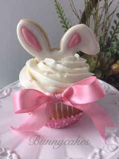 """Easter cupcakes with """"Bunny ear"""" cookie topper made by Bunnycakes cupcakes vanilla Easter Bunny Ear Cupcakes Fondant Cupcakes, Oster Cupcakes, Wedding Cakes With Cupcakes, Birthday Cupcakes, Cupcake Cakes, Mocha Cupcakes, Banana Cupcakes, Gourmet Cupcakes, Strawberry Cupcakes"""