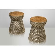 Столешница столика-табурета изготовлена из тикового дерева, основание из алюминия, на который вручную нанесен узор.             Метки: Журнальный стол, Табуреты для кухни.              Материал: Металл, Дерево.              Бренд: NAF-NAF House.              Стили: Лофт.              Цвета: Коричневый, Серый.