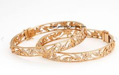 diamond bangles indian | Inspired by nature, this floral creeper designed pair of bangles ...