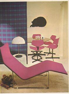 I spy...graphic print artwork, bold coloured furniture, white on white floor, pink accents! 70s interior design.