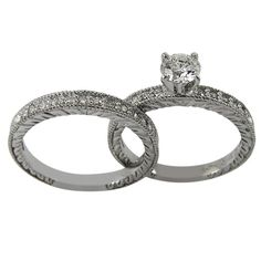 Antique Engagement Mounting With Narrow Engraved Diamond Bands -  This antique engagement set with 0.36ct of round accent diamonds, will accommodate any size or shape of center diamond.    The narrow diamond rings are solid 14K white gold. It has an exchangeable setting. The sides of the both rings have exquisite antique carving.    The settings for our rings are made in our Florida factory using the finest gold and G-H color, SI clarity conflict-free diamonds. Dacarli has been…