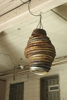 Beautiful industrial rim lampshade ! Made by Christopher Mc Cormick (but i could not find his website). ++ Via here