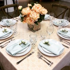 Ivory Tablecloth with a Champagne Lace Overlay. Mint Satin Napkins and Floral accents are great for Spring!