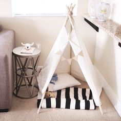 This insanely easy no-sew teepee is perfect for dogs, cats, and you can adjust the size to make it fit kids!