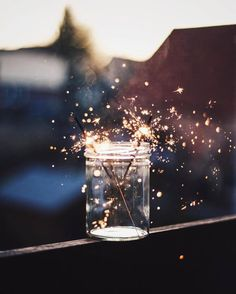 The dusk sky was filled with the sound of our laughter as this great day came to an end. I set my two Sparklers into a glass jar so I could watch them go out. It set a nice ambiance, peaceful with an edge of excitement. I breathed in the crisp scent with a content smile, glancing around at the rest of my friends. I had almost forgot about them in my thoughts of the night ahead.