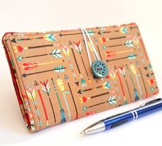 Check out this item in my Etsy shop https://www.etsy.com/listing/543182988/checkbook-cover-in-colorful-arrows