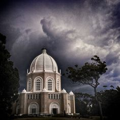 A thunderstorm looms down on the Baha'i Temple in Sydney.