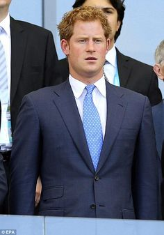 Prince Harry stands for God Save the Queen at the FIFA World Cup Soccer game of England vs Costa Rica June 24, 2014