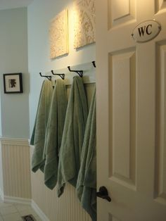 beadboard, color contrast (maybe more gray), like the simple hooks on wood painted same color as wall...great for the boys bathroom