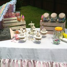 Beautiful treats table at an outdoor baby shower. Vintage and classic combined.