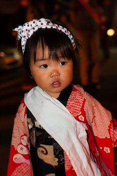 Village child taking part in fire festival by Nicholas Brawn. Kyoto, Japan