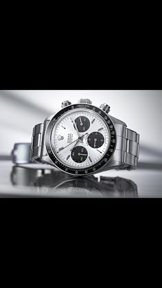 Rolex Daytona Paul Newman Looked so similar to my omega speedy 1957 Panda. I guess my Omega is a homage to this grand daddy